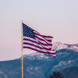 The flag of the United States at sundown.