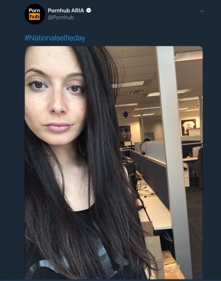 A selfie posted by a social media manager at Pornhub displays a star of David hanging in the office background.